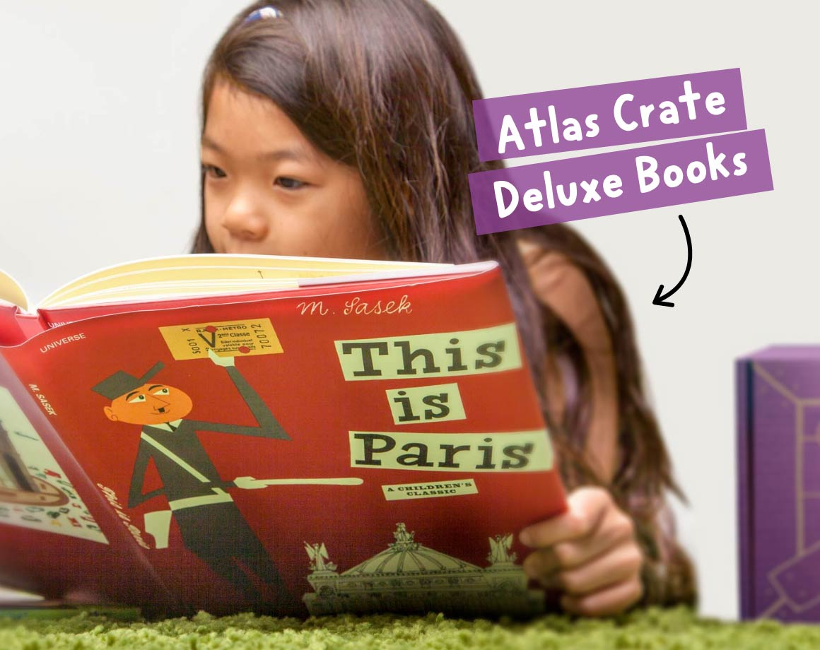 Child reading an Atlas Geography Crate Deluxe Children's Book