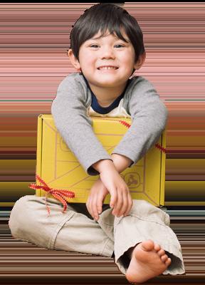 Child with a KiwiCo group birthday present