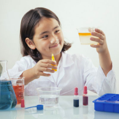 Child experimenting with a common core chemistry kit for 3rd to 5th graders.