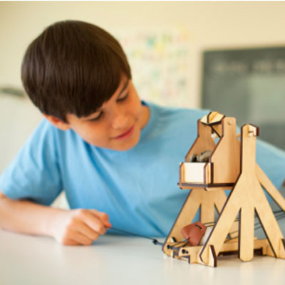 Middle school student with a classroom trebuchet kit.