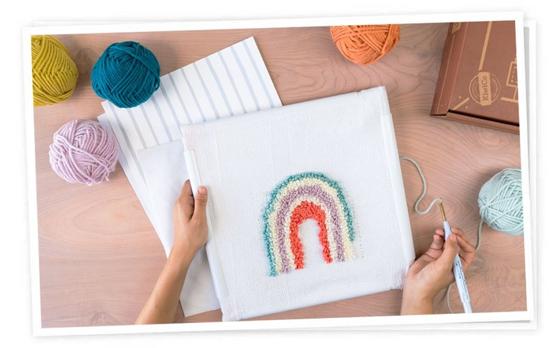 Artist designing a punch needle pillow from Maker Crate monthly craft box