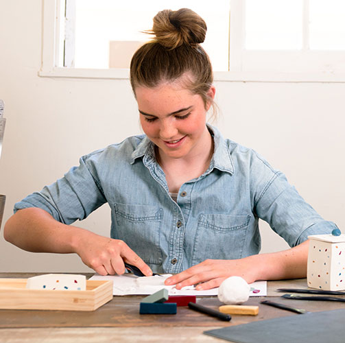 An artist crafting clay organizers from a Maker Crate art subscription box for teens and adults