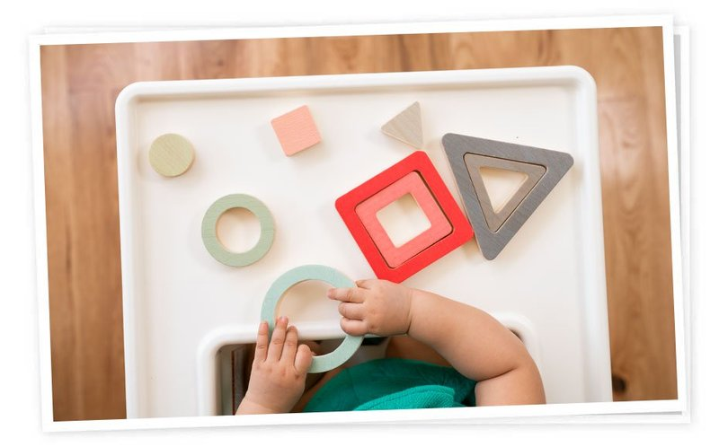 Baby learning shapes through the Panda Crate object sorting game