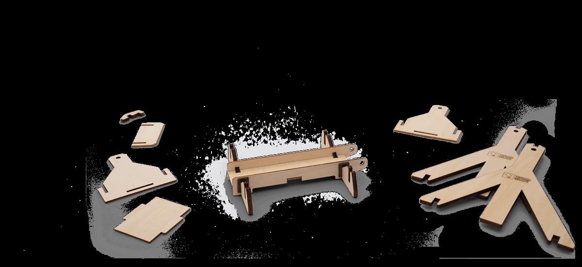 Step 2 of wooden trebuchet kit assembly in progress