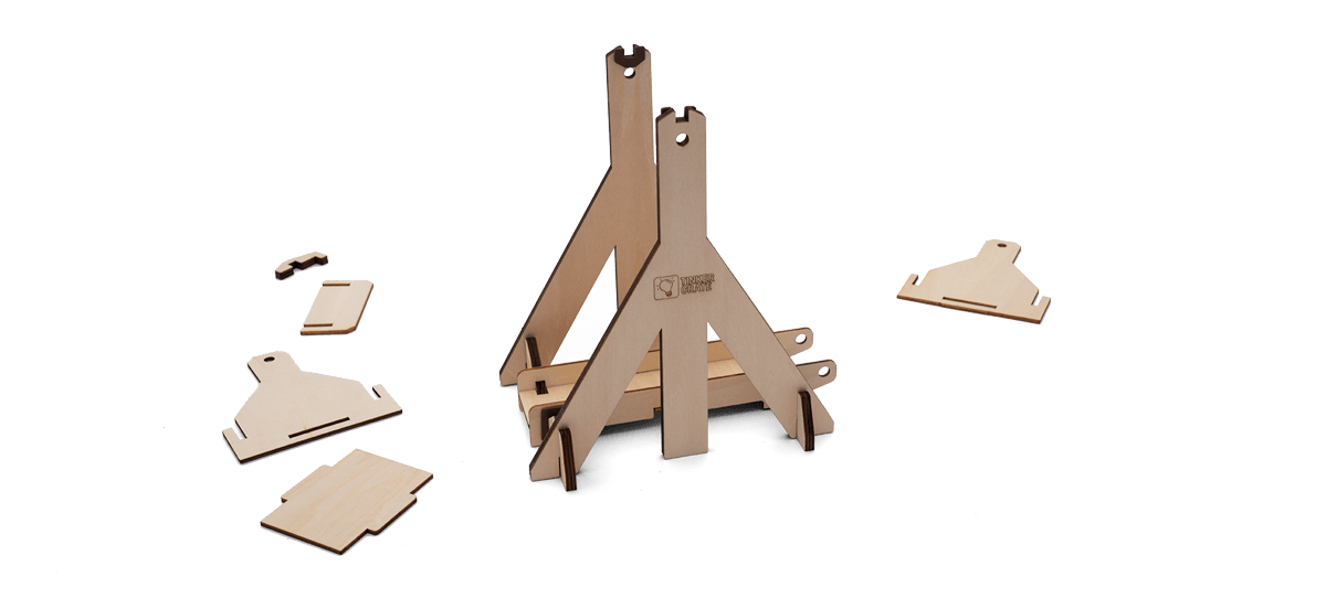 Step 3 of wooden trebuchet kit assembly in progress